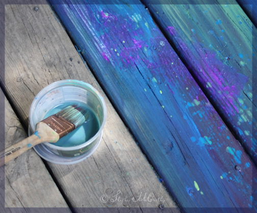Rainbow painting on old wood deck