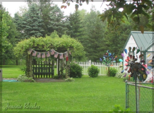 flag bunting on rustic arbor